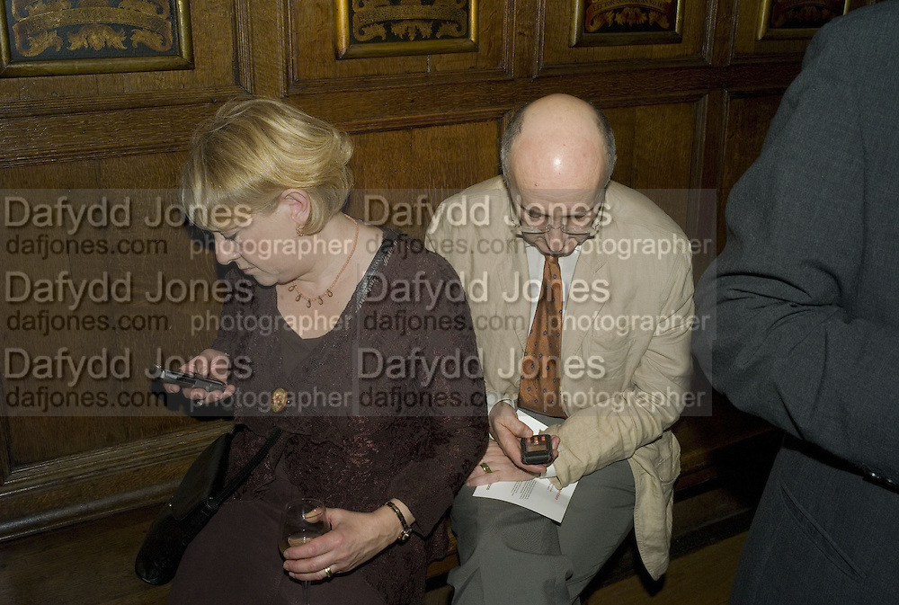 LOUISE AND WINDY DRYDEN TEXTING, CAROLE STONE PARTY.Middle Temple Hall. Middle Temple Lane. London EC4. -DO NOT ARCHIVE-© Copyright Photograph by Dafydd Jones. 248 Clapham Rd. London SW9 0PZ. Tel 0207 820 0771. www.dafjones.com.