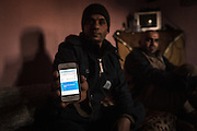 "Mahmoud holds out his phone with the translated message: ""We are here, we have no rights."" Palestinian refugees in Iraq are denied the opportunity to be equal citizens of the country in which they were born."