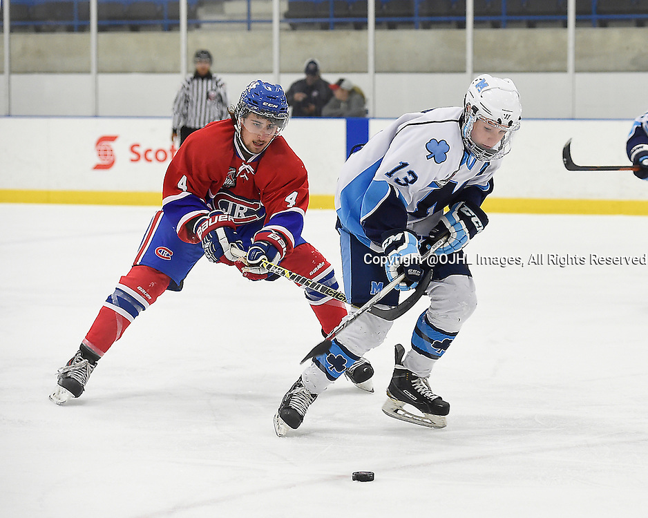 TORONTO, ON - Oct 4, 2015 : Ontario Junior Hockey League game action between St. Michael's and Toronto, Andrew Pucci #4 of the Toronto Jr. Canadiens keeps the puck from Lucas Breault #13 of the St. Michael's Buzzers during the second period.<br /> (Photo by Andy Corneau / OJHL Images)
