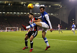 Morgan Fox of Sheffield Wednesday clears the ball from George Baldock of Sheffield United - Mandatory by-line: Robbie Stephenson/JMP - 12/01/2018 - FOOTBALL - Bramall Lane - Sheffield, England - Sheffield United v Sheffield Wednesday - Sky Bet Championship
