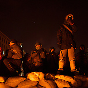 January 24, 2014 - Kiev, Ukraine: Protestors stand guard on top of a defensive barricade near Dynamo Kiev's stadium in central Kiev. (Paulo Nunes dos Santos)