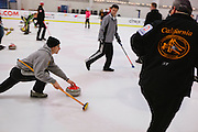 Brian Zaitz of San Jose, left, delivers during the San Francisco Bay Area Curling Club's Tuesday night league at Sharks Ice in San Jose on Jan.15, 2013.