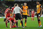 the ref gives warning to Hull City striker Chuba Akpom over altercation in penalty area with Fernando Amorebieta of Middlesbrough FC during the Sky Bet Championship match between Hull City and Middlesbrough at the KC Stadium, Kingston upon Hull, England on 7 November 2015. Photo by Ian Lyall.