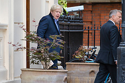 © Licensed to London News Pictures. 19/07/2018. London, UK. Boris Johnson (L) leaves the official residence of the Foreign Secretary the morning after delivering his first speech in parliament since resigning from the government. Photo credit: Rob Pinney/LNP