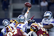 ARLINGTON, TX - NOVEMBER 22:  Dak Prescott #4 of the Dallas Cowboys throws a pass during a game against the Washington Redskins at AT&T Stadium on November 22, 2018 in Arlington, Texas.  The Cowboys defeated the Redskins 31-23.  (Photo by Wesley Hitt/Getty Images) *** Local Caption *** Dak Prescott