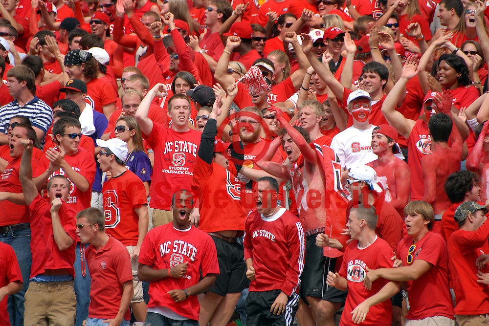 NC State fans whoop it up after a big Wolfpack defensive goal line stop of the ECU Pirates. PHOTO BY ROGER WINSTEAD