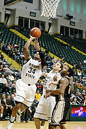 Raider sopphomore Cole Darling (22) watches junior Julius Mays (34) at the basket in the second half as the Idaho Vandals play the Wright State University Raiders at the Nutter Center, Tuesday, December 20, 2011.