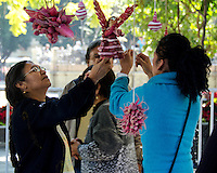 Four women prepare a carved radish angel at the Noche de Rabanos competition, Oaxaca, Mexico.