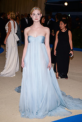 Elle Fanning (wearing Miu Miu) arriving at The Metropolitan Museum of Art Costume Institute Benefit celebrating the opening of Rei Kawakubo / Comme des Garcons : Art of the In-Between held at The Metropolitan Museum of Art  in New York, NY, on May 1, 2017. (Photo by Anthony Behar) *** Please Use Credit from Credit Field ***