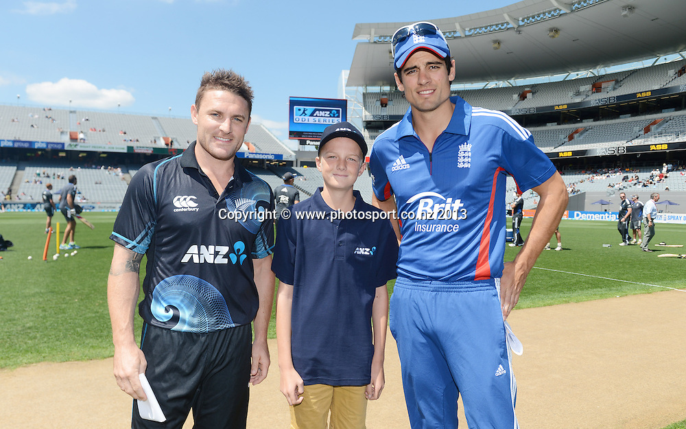 Captains Alastair Cook and Brendon McCullum with the ANZ coin toss winner. Match 3 of the ANZ ODI International one day cricket series. New Zealand Black Caps v England. Eden Park, Auckland on Saturday 23 February 2013. Photo: Andrew Cornaga/Photosport.co.nz
