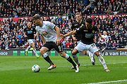 Derby forward Chris Martin turns away from Bolton forward Kaiyne Woolery during the Sky Bet Championship match between Derby County and Bolton Wanderers at the iPro Stadium, Derby, England on 9 April 2016. Photo by Aaron  Lupton.