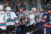KELOWNA, CANADA - DECEMBER 28: Linesmen Dustin Minty and Ward Pateman try to break up players of the Kelowna Rockets and Kamloops Blazers on December 28, 2015 at Prospera Place in Kelowna, British Columbia, Canada.  (Photo by Marissa Baecker/Shoot the Breeze)  *** Local Caption *** Dustin Minty; Ward Pateman;