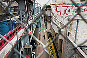 Philadelphia PA / USA. Pedestrians walk below the Market-Frankford elevated train tracks. March 01 2018.