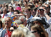 © licensed to London News Pictures. EPSOM, UK.  03/06/11. Crowds at Epsom Derby Ladies Day. Sunshine and wind made for a busy Ladies Day today, 3rd June 2011.  Photo credit should read Stephen Simpson/LNP