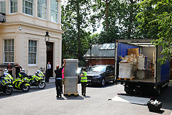 © Licensed to London News Pictures. 09/07/2018. London, UK. A fridge is unloaded from a lorry outside Foreign Secretary Boris Johnson's London home. Photo credit: Rob Pinney/LNP
