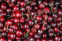 Cherries on a market stall,