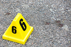 © Licensed to London News Pictures. 19/06/2019. London, UK. An evidence mark next to the blood stains on Carnbrook Road at the junction of Wellbeck Road, Barnet, North London where three men were found to be suffering stab injuries on Tuesday 18 June 2019, just before 11pm. A man in his 30s was treated at the scene, but he was pronounced dead shortly after midnight. Two other men – one in his 20s and one in his 30s were taken to hospital for treatment.  Photo credit: Dinendra Haria/LNP