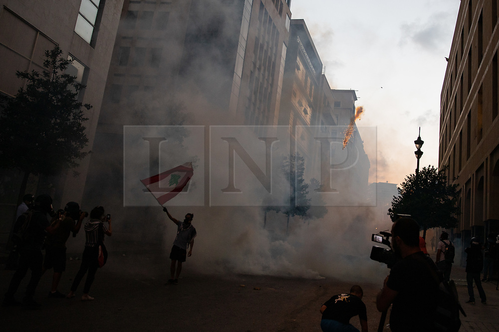 © Licensed to London News Pictures. 10/08/2020. Beirut, Lebanon. Demonstrators clash with the police and army as they protest against the government following a huge explosion in Beirut port on 4 August. Photo credit : Tom Nicholson/LNP