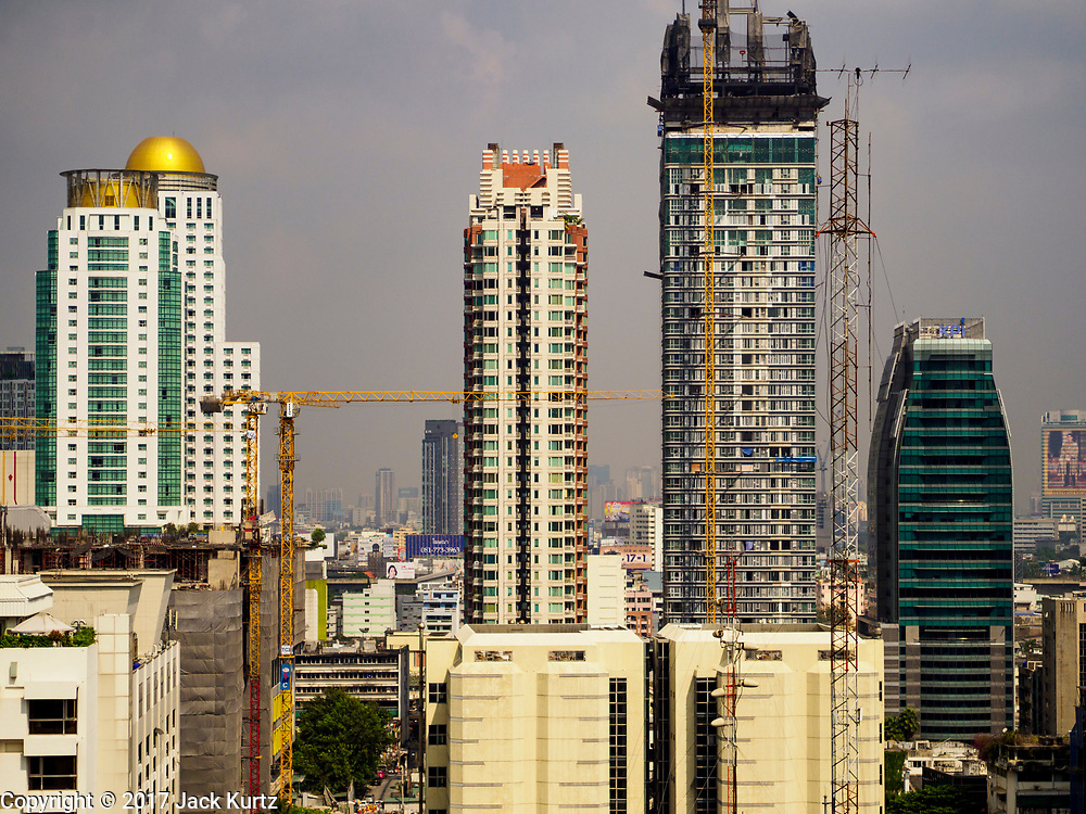 13 DECEMBER 2017 - BANGKOK, THAILAND: The Bangkok skyline from Chit Lom with a mixed use skyscraper under construction.     PHOTO BY JACK KURTZ