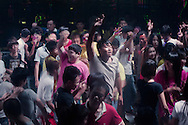 For a story by Dan Levin<br /> FOXCONN<br /> Zhengzhou, June 23rd 2013<br /> Revellers, most of them Foxconn workers at a club in the Foxconn factory town on the outskirts of Zhengzhou.<br /> Gilles Sabrie for The New York Times