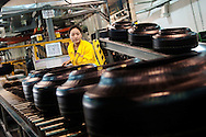 A factory worker inspects tires at the Pirelli tire factory in the city of Jining in Shandong Province, China on Thursday, February 24, 2011. Despite rising rubber costs, Pirelli's CEO Marco Tronchetti Provera sees a stronger than expected growth for tires globally led by China and the Asia pacific region which has allowed them to raise their revenue forecast for Asia from 15% to 20% growth for 2011.