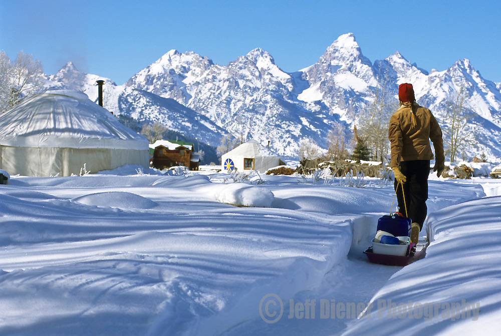 A young woman does chores at the Kelly yurt park in Jackson Hole, Wyoming.