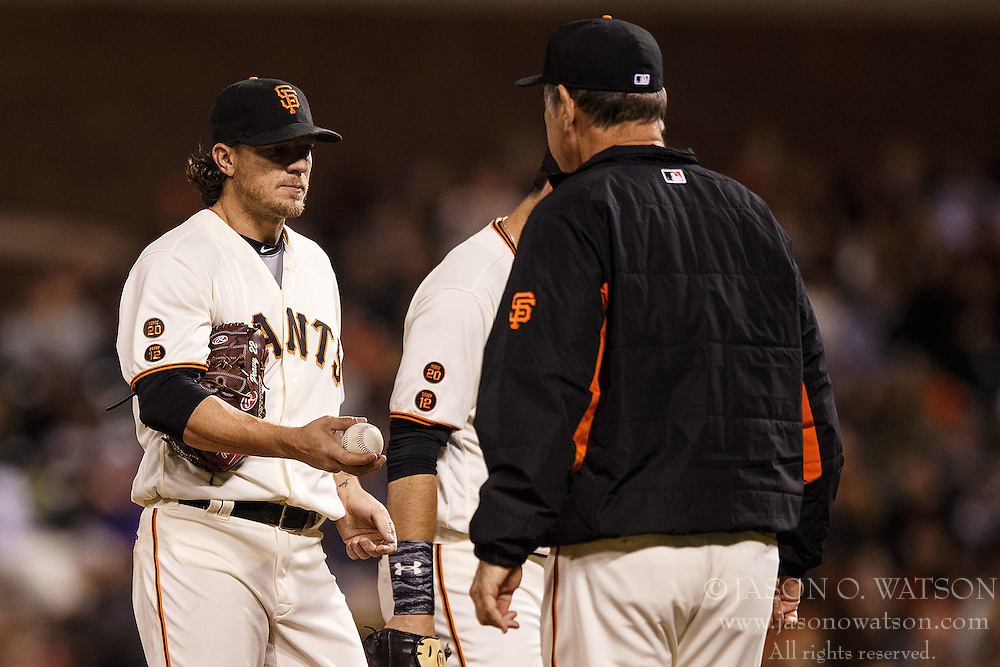 SAN FRANCISCO, CA - APRIL 18: Jake Peavy #22 of the San Francisco Giants is relieved by manager Bruce Bochy #15 during the sixth inning against the Arizona Diamondbacks at AT&T Park on April 18, 2016 in San Francisco, California. The Arizona Diamondbacks defeated the San Francisco Giants 9-7 in 11 innings.  (Photo by Jason O. Watson/Getty Images) *** Local Caption *** Jake Peavy; Bruce Bochy