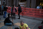 People outside of Cooper Union in New York, NY, on Thursday, May 9, 2013. Over 50 students began a sit-in Wednesday inside the office of the school's president, Jamshed Bharucha, calling for his resignation in protest of the end of free tuition at the school...Photograph by Andrew Hinderaker.
