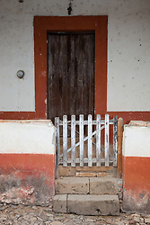 """Gate and Door"" - This old gate and wooden door were photographed in the small mountain town of San Sebastian, Mexico."