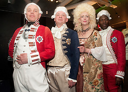 The Hubs, Hallam Union, Paternoster Row plays host to Sheffield's biggest Fancy Dress Ball. More than 900 people in fancy dress to raise money for Cancer Research on Saturday night.Dressed in curtains wearing Home Made outfits Left to right Master of the sewing machine Mel Housley, DJ Antony Watts, Wendy Hebb and Renaldo Robinson..6 April  2013.Image © Paul David Drabble