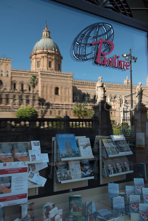 The cathedral reflected on the display of religious bookshop nearby