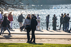 © Licensed to London News Pictures. 30/12/2019. London, UK. A young couple enjoy an unseasonably mild sunny day in Hyde Park, London as forecasters predict warm weather and possibly the the warmest New Year's Eve for over a 170 years. Photo credit: Alex Lentati/LNP