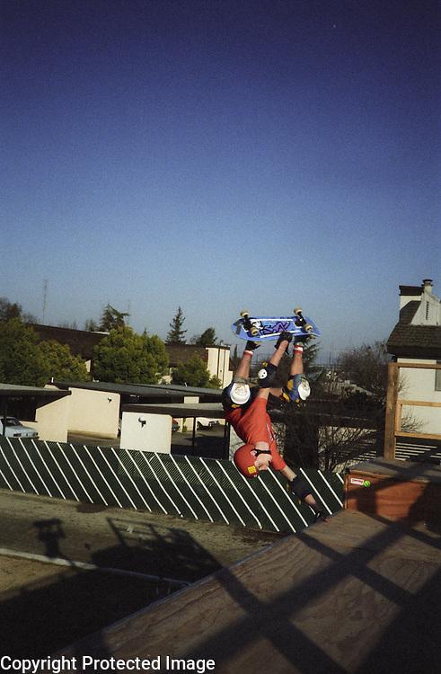 "Hugh ""Bod"" Boyle does a handplant at the YMCA ramp in Visalia, California."