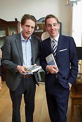 Repro Free: Ryan Tubridy pictured at The Little Museum of Dublin lecture series sponsored by Carmen Wines and Davy Stokebrokers with the museum founder Trevor White. The lecture, which was hosted by Ryan Tubridy and focused on JFK's visit to Ireland, was part of on-going series of lectures taking place at the museum in 2013. For more information visit www.littlemuseum.ie. Picture Andres Poveda