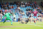 Rotherham United midfielder Jon Taylor (11) scores the opening goal for Rotherham during the EFL Sky Bet League 1 match between Scunthorpe United and Rotherham United at Glanford Park, Scunthorpe, England on 12 May 2018. Picture by Nigel Cole.