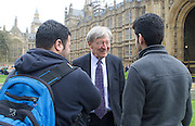 Refugee children and Lord Alf Dubs gather on College Green ahead of <br /> today&rsquo;s vote on amendment to the Immigration Bill (which could see 3,000 unaccompanied refugee children in Europe given sanctuary in the UK).<br /> <br /> The children have been allowed safe passage to the UK to be reunited with family members following action by Citizens UK to enable them to access their legal rights. Under Dublin III regulations, unaccompanied refugee minors in Europe have a legal right to be with their families in the UK whilst their asylum claims are assessed. <br /> <br /> 25th April 2016 <br /> <br /> Lord Dubs with the two refugee boys who are from Darʿā in Syria who arrived in UK via Calais. <br /> <br /> <br /> Photograph by Elliott Franks <br /> Image licensed to Elliott Franks Photography Services