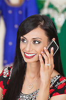 Beautiful Indian woman answering phone call