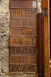 An old store sign adds texture to San Gimignano.