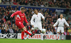 LIVERPOOL, ENGLAND - SUNDAY MARCH 27th 2005: Liverpool Legends' Jan Mølby and Celebrity XI's Amir Khan during the Tsunami Soccer Aid match at Anfield. (Pic by David Rawcliffe/Propaganda)