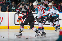 KELOWNA, CANADA - JANUARY 18: Yan Khomenko #17 of the Moose Jaw Warriors back passes the puck after the face off against Calvin Thurkauf #27 of the Kelowna Rockets on January 18, 2017 at Prospera Place in Kelowna, British Columbia, Canada.  (Photo by Marissa Baecker/Shoot the Breeze)  *** Local Caption ***
