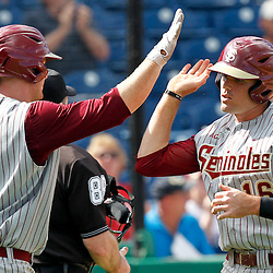 February 29, 2012; Clearwater, FL, USA; Florida State University first baseman Jayce Boyd is greeted by teammate Stephen McGee (9) after scoring a run during a spring training exhibition game against the Philadelphia Phillies at Bright House Networks Field. The Phillies defeated Florida State 6-1. Mandatory Credit: Derick E. Hingle-US PRESSWIRE