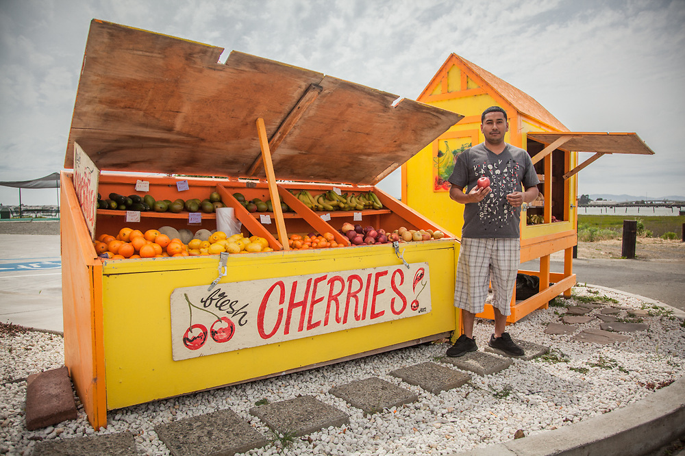 "Carlos Ortega of Sunshine Smoothies & Coffee, Vallejo, CA.  ""I am a farmer by trade...we were tired of throwing away our fruit so we started this stand."""
