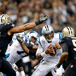 Dec 8, 2013; New Orleans, LA, USA; Carolina Panthers quarterback Cam Newton (1) is pressured by New Orleans Saints outside linebacker Junior Galette (rear) and defensive end Cameron Jordan (94) and defensive end Akiem Hicks (76) during the first quarter of a game at Mercedes-Benz Superdome. Mandatory Credit: Derick E. Hingle-USA TODAY Sports