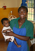 A NANNY AND VERY YOUNG ORPHAN AT KONDANANI CHILDRENS ORPHANAGE IN BLANTYRE MALAWI SOUTH EASTERN AFRICA.23.11.06.PIX STEVE BUTLER