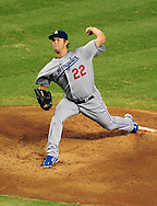 Jul. 15 2011; Phoenix, AZ, USA; Los Angeles Dodgers starting pitcher Clayton Kershaw (22) delivers a pitch during the first inning against the Arizona Diamondbacks at Chase Field. The Dodgers defeated the Diamondbacks 6-4. Mandatory Credit: Jennifer Stewart-US PRESSWIRE..