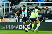 Allan Saint-Maximin (#10) of Newcastle United takes on Adam Smith (#15) of AFC Bournemouth during the Premier League match between Newcastle United and Bournemouth at St. James's Park, Newcastle, England on 9 November 2019.