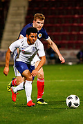 Chris Cadden Scotland U21s (Motherwell FC) chases down Jay DaSilva England U21s (Bristol City - on loan from Premier League club Chelsea) during the U21 UEFA EUROPEAN CHAMPIONSHIPS match Scotland vs England at Tynecastle Stadium, Edinburgh, Scotland, Tuesday 16 October 2018.