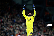 Liverpool goalkeeper Alisson Becker (13) celebrates Liverpool's goal during the Premier League match between Liverpool and Arsenal at Anfield, Liverpool, England on 29 December 2018.