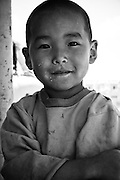 A young boy poses in rural Mongolia.