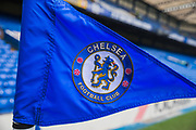 Corner flag for Chelsea FC on the pitch at Stamford Bridge ahead of the Premier League match between Chelsea and West Ham United at Stamford Bridge, London, England on 8 April 2019.